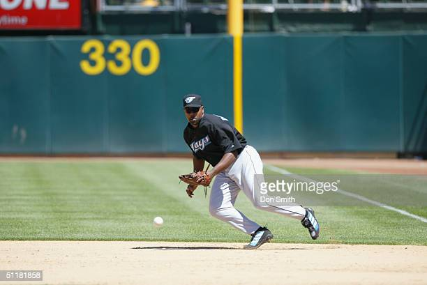 Carlos Delgado of the Toronto Blue Jays fields during the MLB game against the Oakland A's at the Network Associates Coliseum on July 20 2004 The A's...