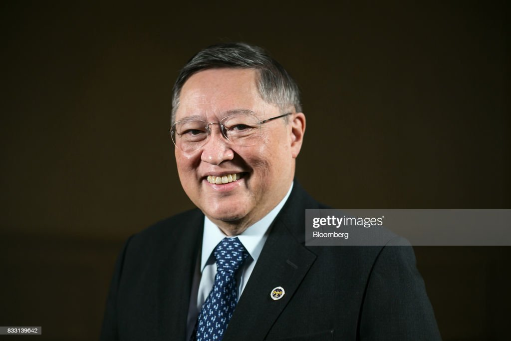Carlos Dominguez, the Philippines' secretary of finance, poses for a photograph after a Bloomberg Television interview in Singapore, on Tuesday, Aug. 15, 2017. Dominguezsaid the economy is set to continue growing strongly, with a slump in the currency likely to be temporary. Photographer: Sam Kang Li/Bloomberg via Getty Images