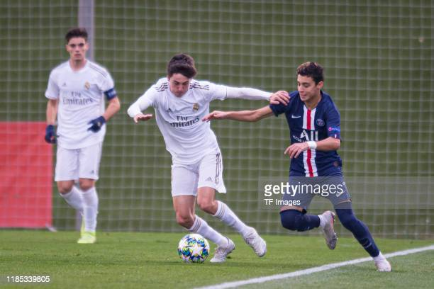Carlos Dotor Gonzalez of Real Madrid and Kays RuizAtil of Paris SaintGermain battle for the ball during the match between Real Madrid and Paris...