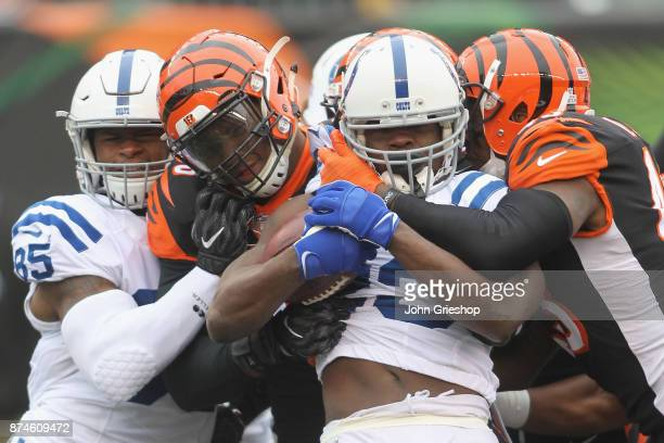 Carlos Dunlap and George Iloka of the Cincinnati Bengals make the tackle on Frank Gore of the Indianapolis Colts during their game at Paul Brown...
