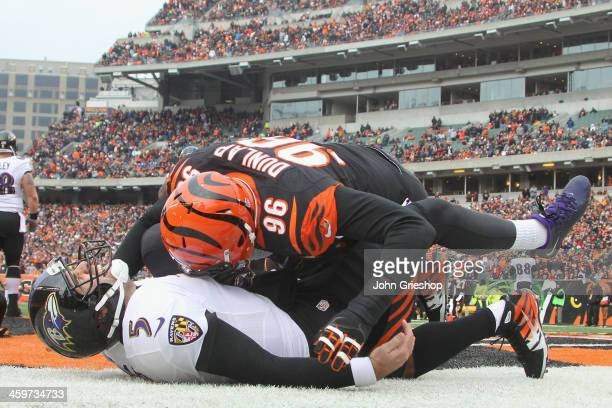 Carlos Dunlap of the Cincinnati Bengals slams Joe Flacco of the Baltimore Ravens to the turf during their game at Paul Brown Stadium on December 29,...