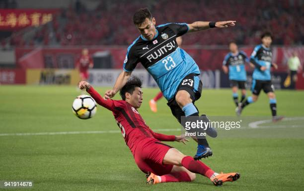 Carlos Eduardo Bendini Giusti of Kawasaki Frontale and Fu Huan of Shanghai SIPG in action during the 2018 AFC Champions League match between Shanghai...