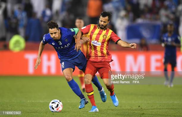 Carlos Eduardo of Al Hilal SFC is brought down by Taha Khenissi of Esperance Sportive de Tunis during the FIFA Club World Cup 2nd round match between...