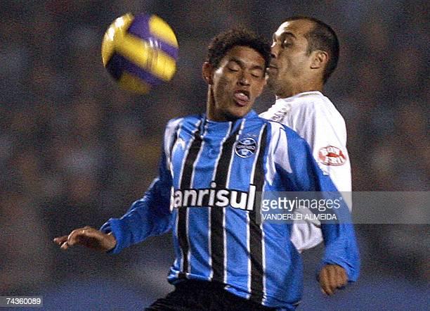 Carlos Eduardo of Gremio vies with Alessandro Nunes of Santos during a Libertadores Cup semifinals match at Olimpico Stadium in Porto Alegre Brazil...