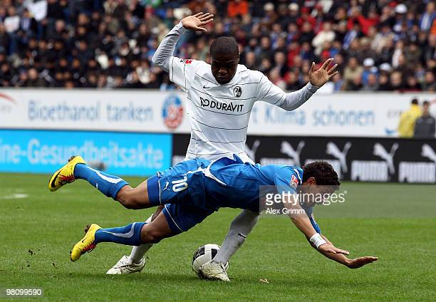 Carlos Eduardo of Hoffenheim is challenged by Cedric Makiadi of Freiburg during the Bundesliga match between 1899 Hoffenheim and SC Freiburg at the...