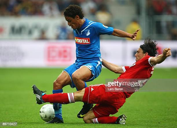 Carlos Eduardo of Hoffenheim is tackled by Danijel Pranjic of Bayern during the Bundesliga match between 1899 Hoffenheim and FC Bayern Muenchen at...