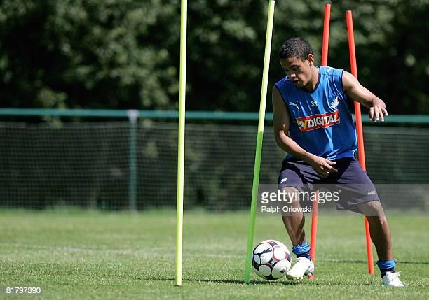 Carlos Eduardo of TSG 1899 Hoffenheim kicks a ball during a training session at their training camp on July 2, 2008 in Stahlhofen near Limburg,...