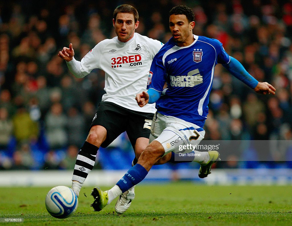 Carlos Edwards (R) of Ipswich battles for the ball against Angel Rangel of Swansea during the npower Championship match between Ipswich Town and Swansea City at Portman Road on December 4, 2010 in Ipswich, England.