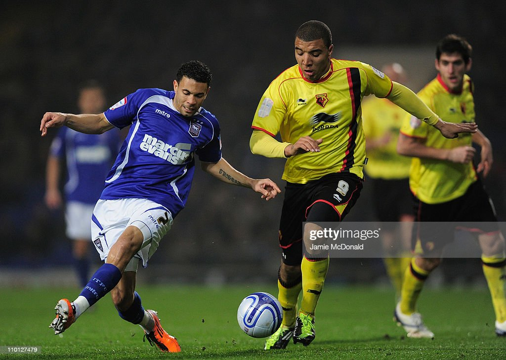 Carlos Edwards of Ipswich Town battles with Troy Deeney of Watford during the npower Championship match between Ipswich Town and Watford at Portman Road on March 15, 2011 in Ipswich, England.