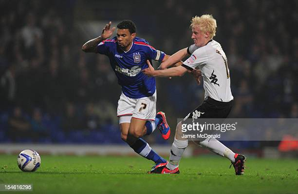 Carlos Edwards of Ipswich Town skips the tackle of Will Hughes of Derby County during the npower Championship match between Derby County and Ipswich...