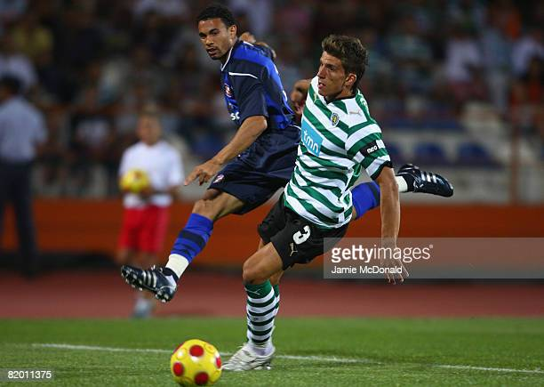 Carlos Edwardsof Sunderland battles with D Carrico of Lisbon during the preseason friendly match between Sporting Lisbon and Sunderland at the...