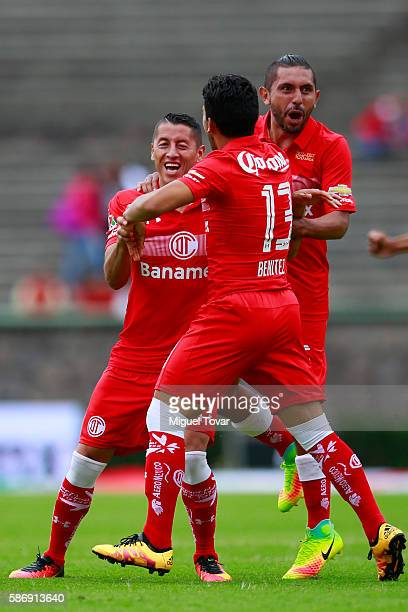Carlos Esquivel of Toluca celebrates with teammates after scoring during the 4th round match between Toluca and Pachuca as part of the Torneo...