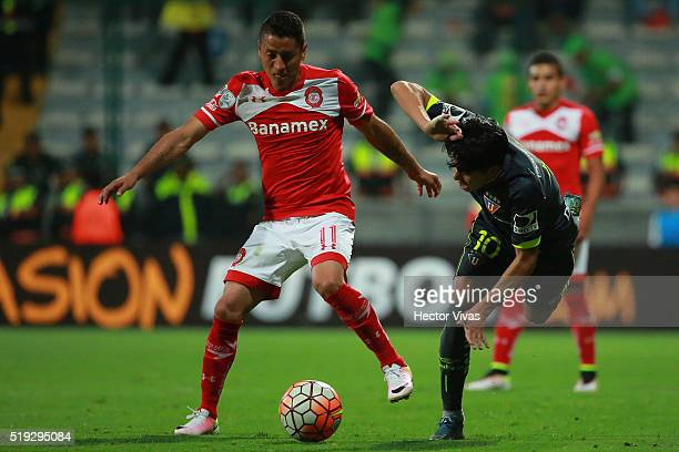 Carlos Esquivel of Toluca struggles for the ball with Diego Morales of LDU Quito during a match between Toluca and LDU Quito as part of the Copa...