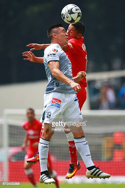 Carlos Esquivel of Toluca struggles for the ball with Efrain Velarde of Leon during the 11th round match between Toluca and Leon as part of the...