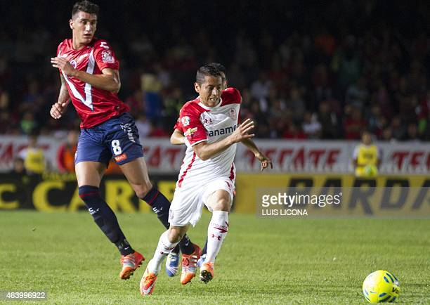 Carlos Esquivel of Toluca vies for the ball with Gabriel Peñalba of Veracruz during their Mexican Clausura tournament football match at the Luis...