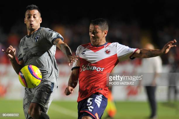 Carlos Esquivel of Veracruz vies for the ball with Leonel Vangioni of Monterrey during their Mexican Clausura tournament football match at the Luis...