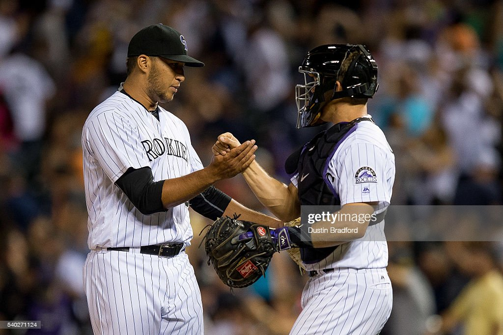 Carlos Estevez #54 and Nick Hundley #4 of the Colorado Rockies celebrate a 13-10 win over the New York Yankees during a regular season interleague game at Coors Field on June 14, 2016 in Denver, Colorado.