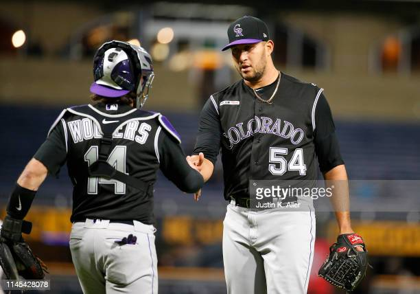 Carlos Estevez of the Colorado Rockies celebrates with Tony Wolters after defeating the against the Pittsburgh Pirates 5-0 at PNC Park on May 21,...
