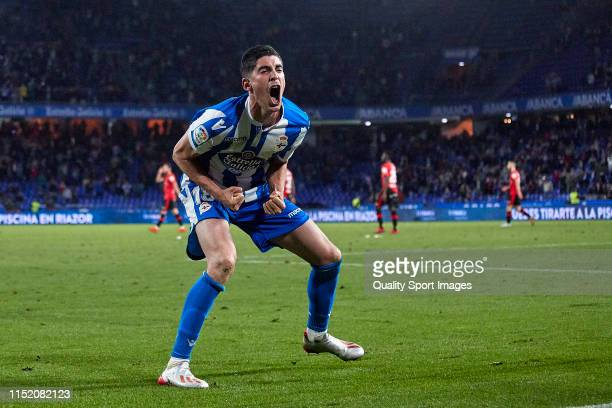 Carlos Fernandez of Deportivo de La Coruna celebrates after scoring his team's first goal during the La Liga 123 match between Deportivo de La Coruna...