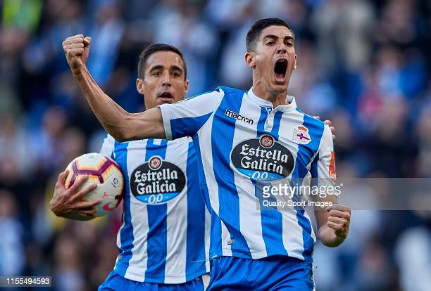 Carlos Fernandez of Deportivo de La Coruna celebrates after scoring his team's first goal during the La Liga 123 play off match between Deportivo De...