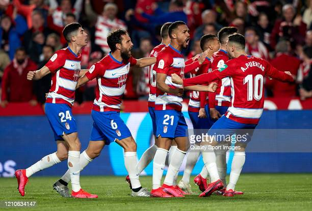Carlos Fernandez of Granada celebrates after scoring his team's first goal with his teammates during the Copa del Rey Semi Final second leg match...