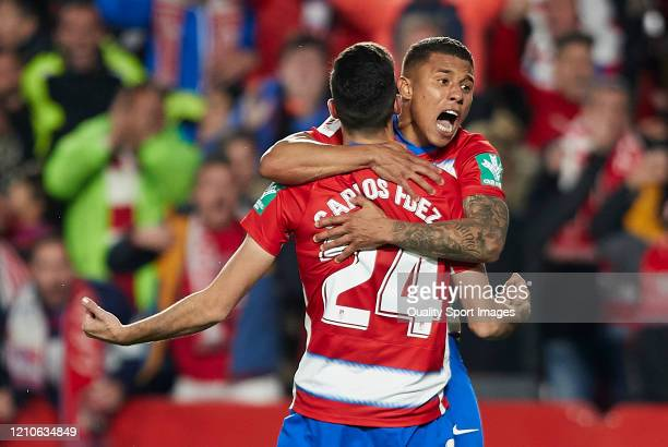 Carlos Fernandez of Granada celebrates after scoring his team's first goal with his teammate Darwin Machis during the Copa del Rey Semi Final second...