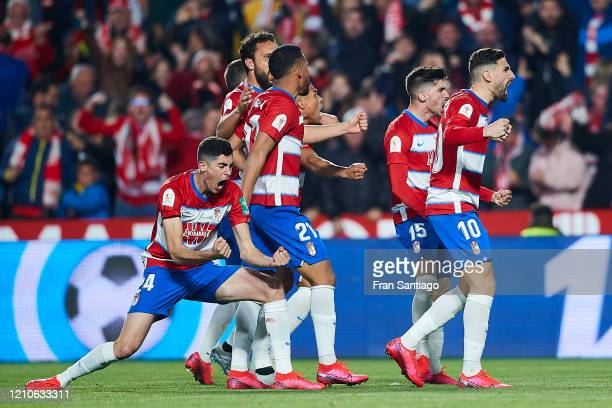 Carlos Fernandez of Granada CF celebrates scoring his team's opening goal with team mates during the Copa del Rey semi-final 2nd leg match between...