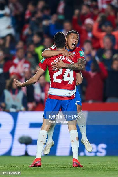 Carlos Fernandez of Granada CF celebrates scoring his team's opening goal with team mates during the Copa del Rey semifinal 2nd leg match between...