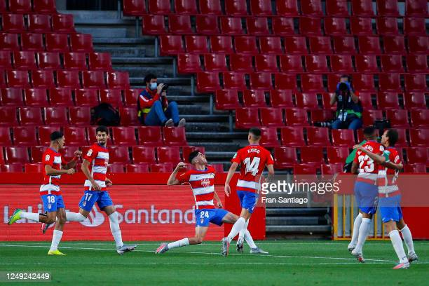 Carlos Fernandez of Granada CF celebrates with his team mates after scoring his team's first goal during the Liga match between Granada CF and Getafe...