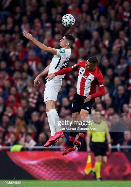 Carlos Fernandez of Granada CF duels for the ball with Dani Garcia of Athletic Club during the Copa del Rey Semi-Final 1st Leg match between Athletic...