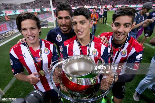 Carlos Fierro, Angel Zaldivar, Alan Pulido and Rodolfo Pizarro of Chivas celebrate with the trophy after winnig the final match between Chivas and...
