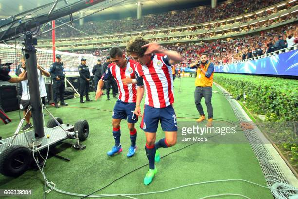 Carlos Fierro of Chivas celebrates with teammate Orbelin Pineda after scoring his team's winning goal during the 13th round match between Chivas and...