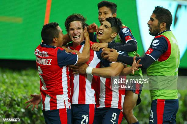 Carlos Fierro of Chivas celebrates with teammates after scoring his team's winning goal during the 13th round match between Chivas and Puebla as part...
