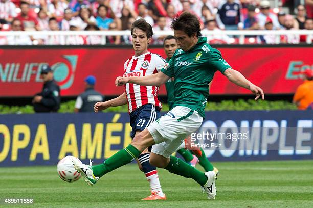 Carlos Fierro of Chivas fights for the ball with Ignacio Gonzalez of Leon during a match between Chivas and Leon as part of 13th round of Clausura...