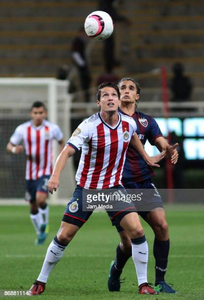 Carlos Fierro of Chivas fights for the ball with Irving Zurita of Atlante during the quarter final match between Chivas and Atlante as part of the...