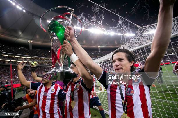 Carlos Fierro of Chivas lifts the trophy to celebrate after winning the final match between Chivas and Morelia as part of the Copa MX Clausura 2017...