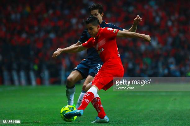 Carlos Fierro of Chivas struggles for the ball with Efrain Velarde of Toluca during the semifinals first leg match between Toluca and Chivas as part...