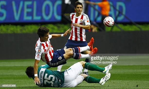 Carlos Fierro of Chivas vies of the ball with Ignacio Gonzalez of Leon during their Mexican Clausura 2015 tournament football match at Omnilife...