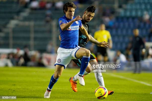 Carlos Fierro of Cruz Azul and Luis Noriega of Queretaro fight for the ball during the 10th round match between Cruz Azul and Queretaro as part of...