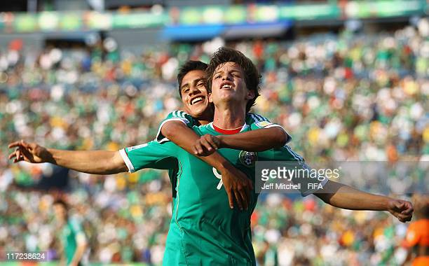 Carlos Fierro of Mexico celebrates with Julio Gomez after scoring against Netherlands during the Group A FIFA U-17 World Cup match between Mexico and...