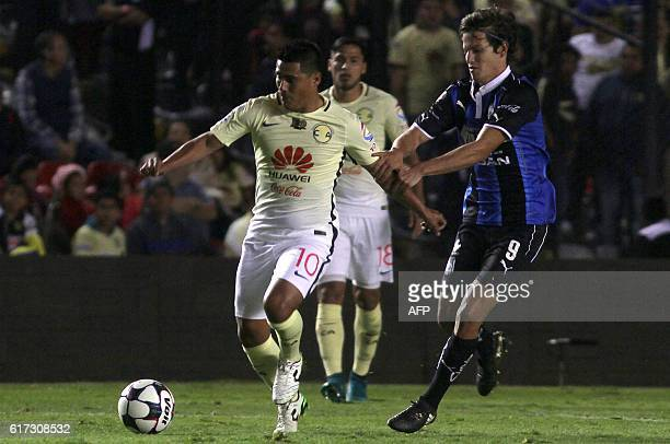 Carlos Fierro of Queretaro vies for the ball with Osvaldo Martinez of America during their Mexican Apertura 2016 Tournament football match at La...