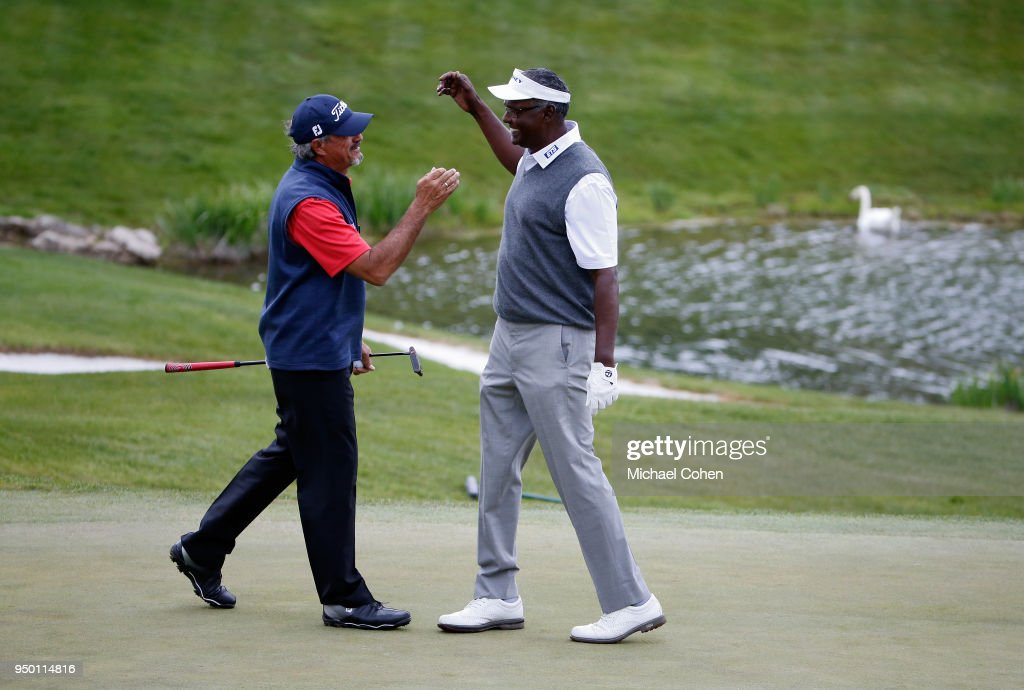 Carlos Franco of Paraguay and partner Vijay Singh of Fiji Islands celebrate Franco's long birdie putt on the 14th green during the final round of the PGA TOUR Champions Bass Pro Shops Legends of Golf at Big Cedar Lodge held at Top of the Rock on April 22, 2018 in Ridgedale, Missouri.