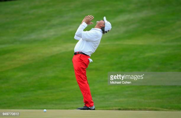 Carlos Franco of Paraguay reacts to his missed birdie putt on the 18th green during the third round of the PGA TOUR Champions Bass Pro Shops Legends...