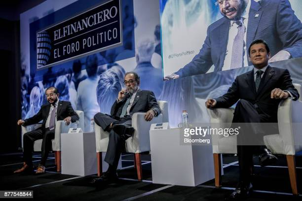 Carlos Fuente president of the Partido Verde right and Hugo Flores president of the Encuentro Social party center listen during the El Financiero...