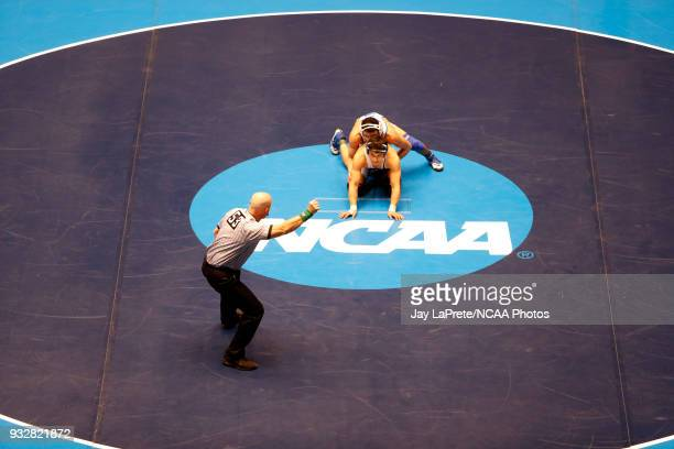 Carlos Fuentez of Wheaton wrestles Jay Albis of Johnson Wales in the 125 weight class during the Division III Men's Wrestling Championship held at...