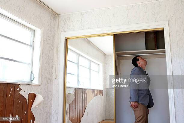 Carlos Gancedo looks at the ceiling in a closet as an agent from Re/Max Advance Realty shows him the home for sale as the National Association of...