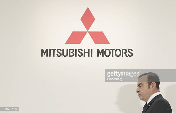 Carlos Ghosn chairman and chief executive officer of Renault SA and Nissan Motor Co arrives for a news conference in Tokyo Japan on Thursday Oct 20...