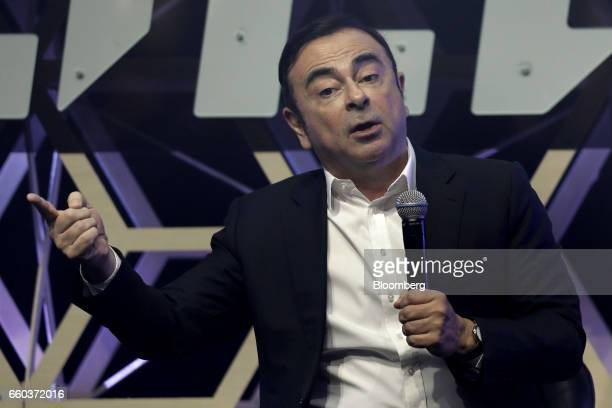 Carlos Ghosn chairman of Nissan Motor Co and chief executive officer of Renault SA speaks during the Slush Tokyo startups event in Tokyo Japan on...