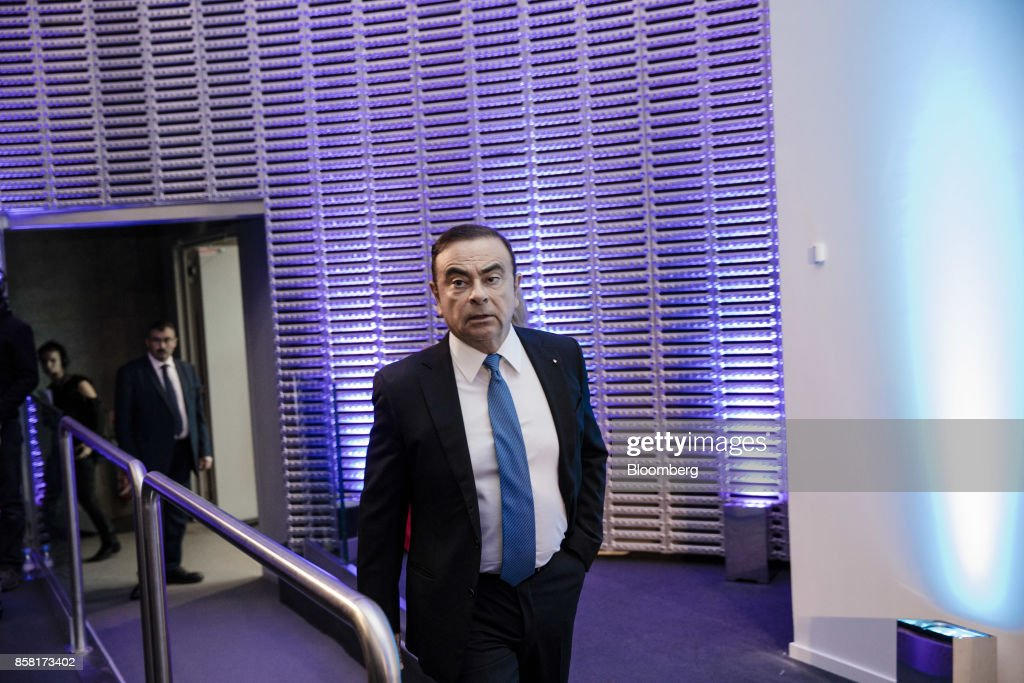 Carlos Ghosn, chairman of Renault SA, arrives for a news conference to announce the automaker's strategic plan in Paris, France, on Friday, Oct. 6, 2017. Renault raised mid-term sales and earnings targets as part of the French carmakers plan to protect its leadership in battery-powered autos and keep pace with rivals in driverless models. Photographer: Marlene Awaad/Bloomberg via Getty Images