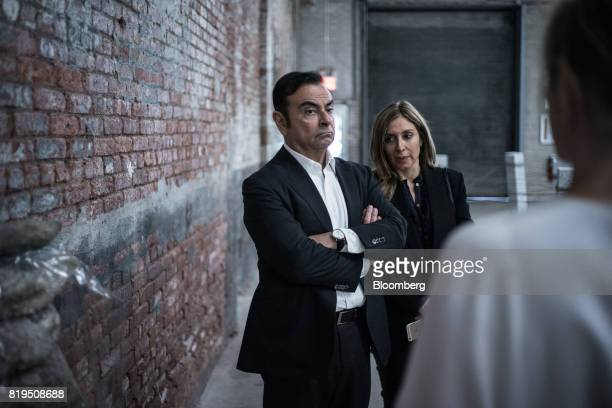 Carlos Ghosn chairman of Renault SAS Nissan Motor Co and Mitsubishi Motors Corp left and his wife Carole Nahas view artwork at the DIA Art Foundation...